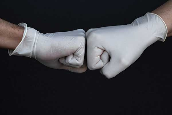 Gloved fist bump