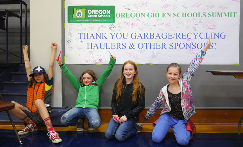 Students in front of banner for Oregon Green Schools