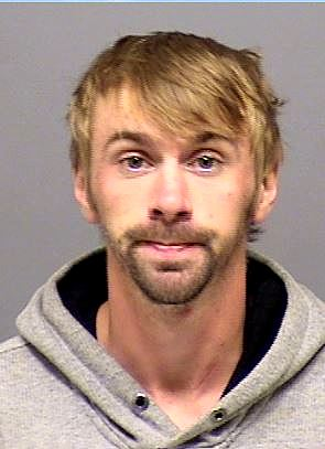2015 booking photo of Joshua Kenneth Derrick, sought by police