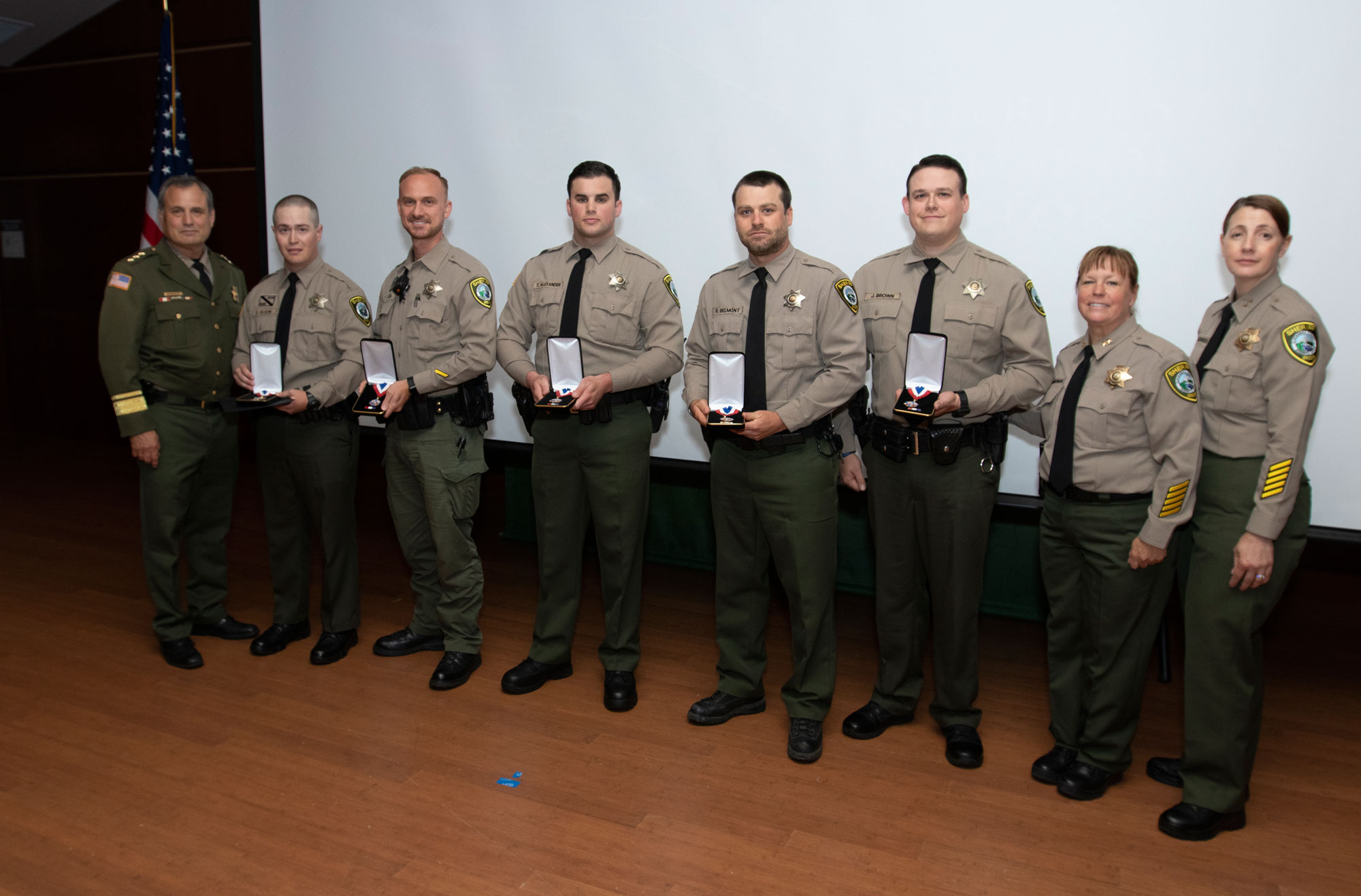 Sheriff Roberts; Deputies Olson, Adel, Alexander, Belmont and Brown; Undersheriff Brandenburg; and Chief Deputy Morrison.