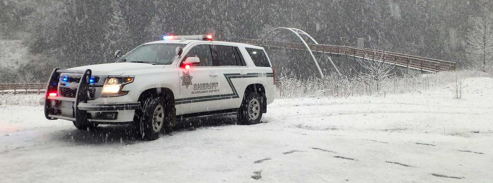 Patrol vehicle in falling snow